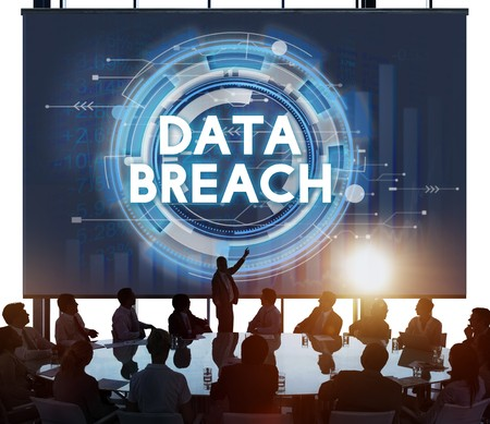 Group of business associates discussing data breach information