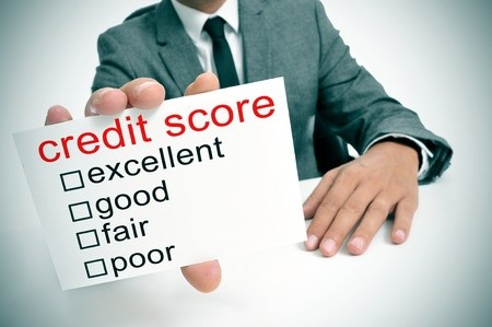 Business man holding credit score rating card