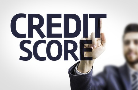Business man pointing to credit score text