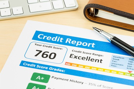 Credit report with 760 score on desk