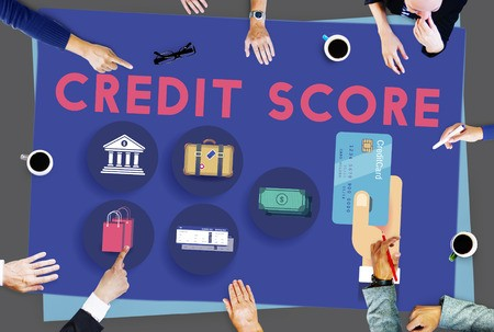 Credit score and credit card with many hands on table