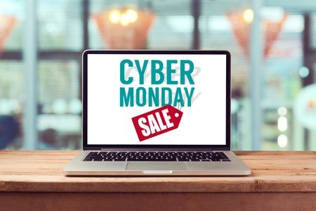 Cyber Monday sale tag displayed on laptop near store