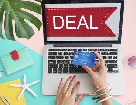Woman deal shopping online with laptop and credit card