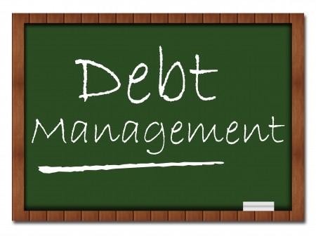 Debt management written on classroom chalk board