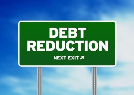 Debt reduction next exit sign