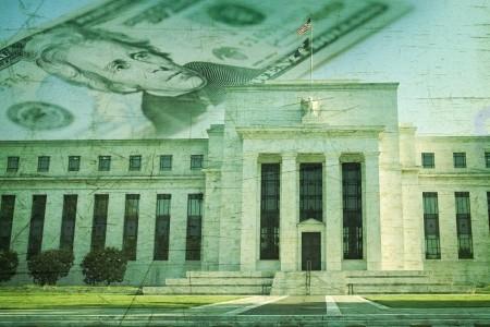 Federal reserve building in Washington DC superimposed on twenty dollar bill