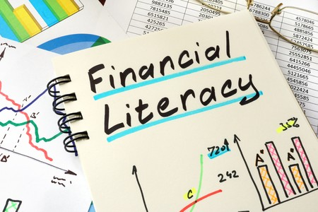 Financial literacy charts and graphs written on notepad sheet for educational purposes