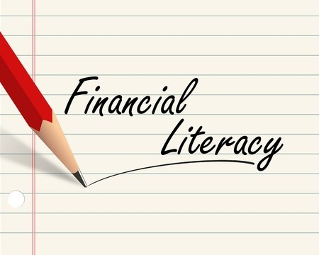 Pencil writing financial literacy on paper
