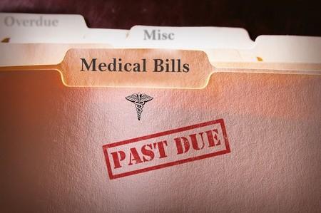 File folder with past due medial bills