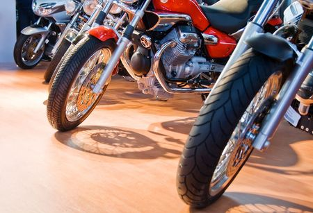 Front wheel of several motorcycles aligned for sale