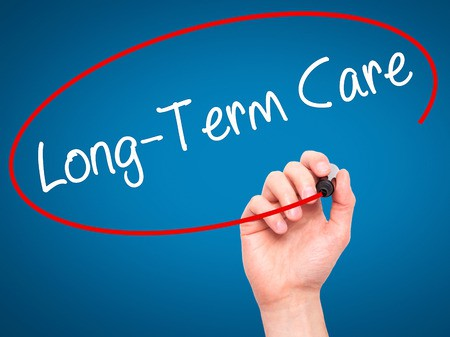 Woman insurance agent circling the words long term care