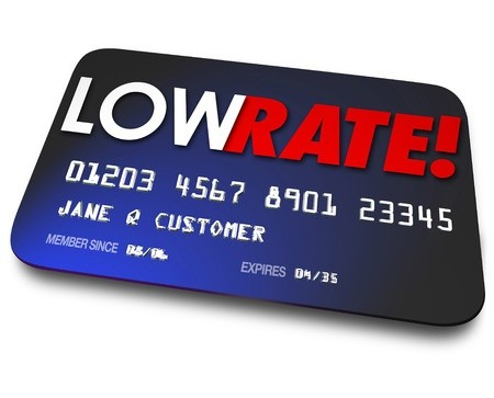 Words low rate written on blue credit card