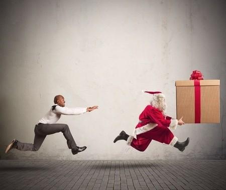 Man chasing Santa Clause stealing a gift