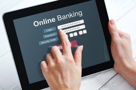 Female using online banking on tablet