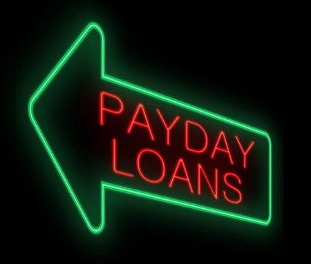 Payday Loans lit up on neon green arrow