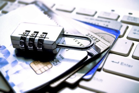 Security lock atop credit cards and computer keyboard