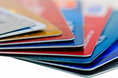 Several red, blue and gold credit cards